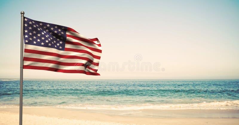 Os EUA embandeiram na praia fotografia de stock royalty free