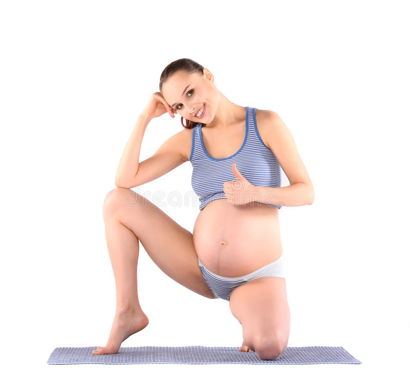 Os exercícios pré-natais da mulher imagem de stock