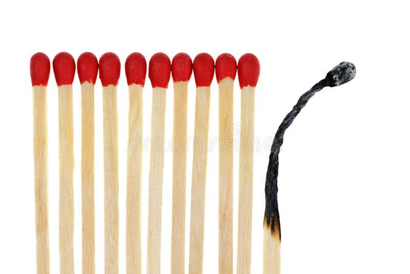 Os fósforos com um queimam-se fotografia de stock