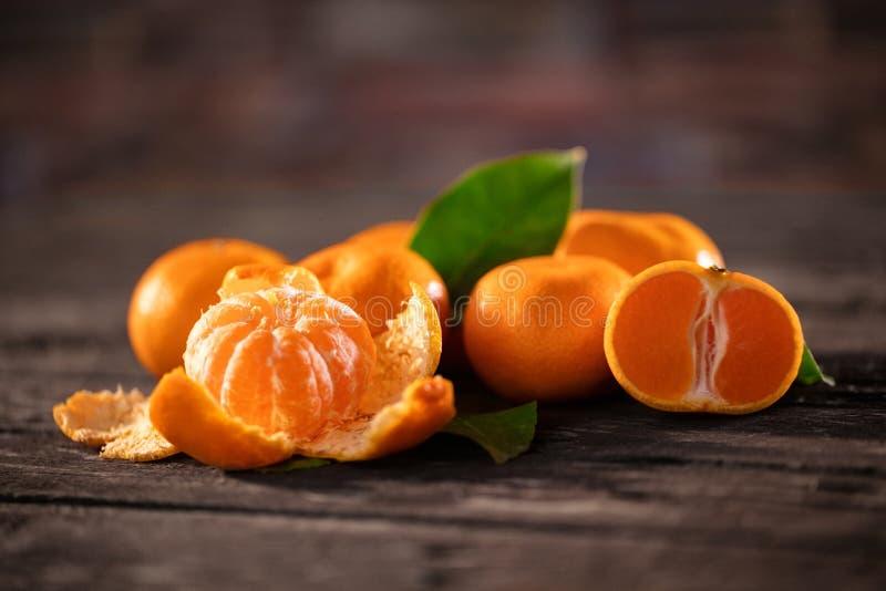 Os frutos saudáveis, tangerina frutificam fundo muito fruto da tangerina foto de stock