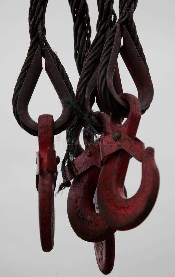 Os ganchos nas cordas fotografia de stock