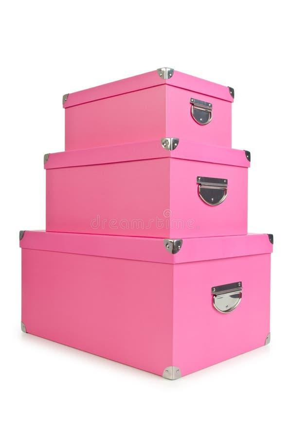 Os giftboxes cor-de-rosa isolados no branco imagem de stock