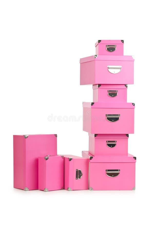 Os giftboxes cor-de-rosa isolados no branco fotografia de stock