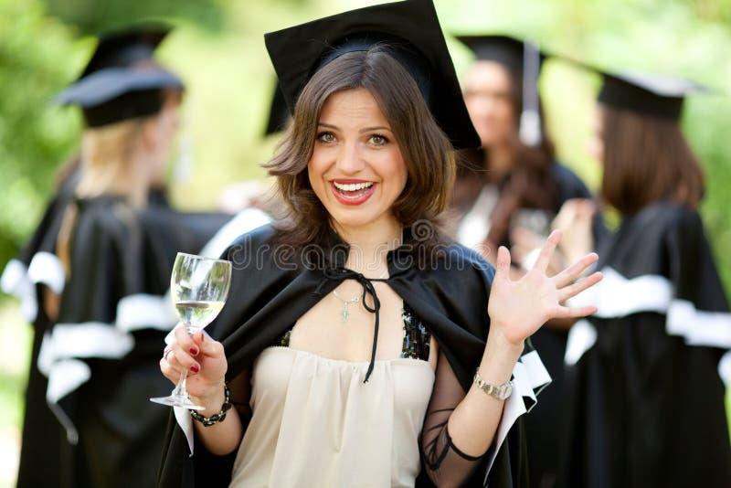 Os graduados do celibatário comemoram fotografia de stock royalty free