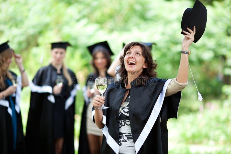 Os graduados do celibatário comemoram fotos de stock royalty free