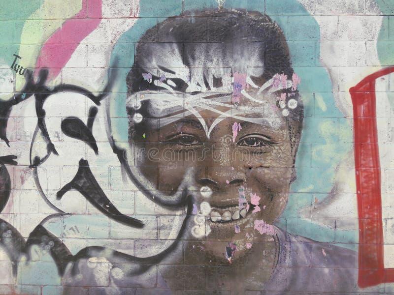 Os grafittis da menina da arte em Cidade do México sob a estrada relacionaram-se ao presidente esquerdista do partido em relação  foto de stock royalty free
