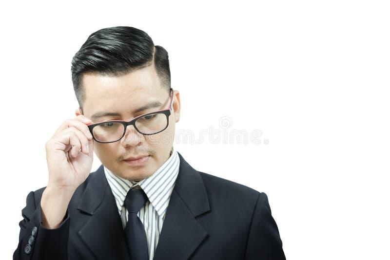 Os homens de negócios asiáticos estão pensando de algo fotos de stock royalty free