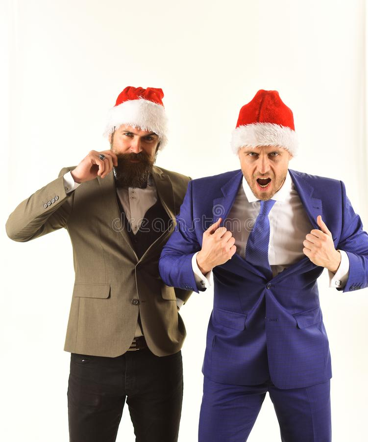 Os homens de negócios com caras raging mostram a força e a confiança fotografia de stock royalty free