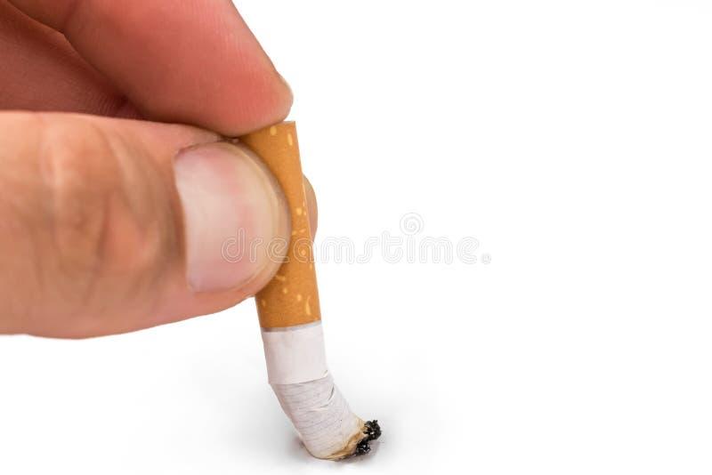 Os homens entregam expressam o cigarro na frente do fundo branco fotos de stock royalty free