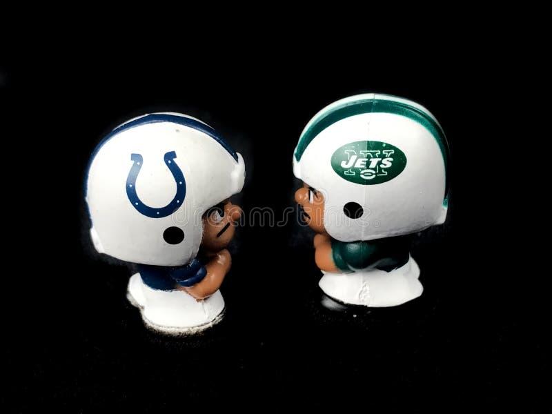 Os Indianapolis Colts e o ` L colega de equipa de Li dos New York Jets brincam imagem de stock royalty free