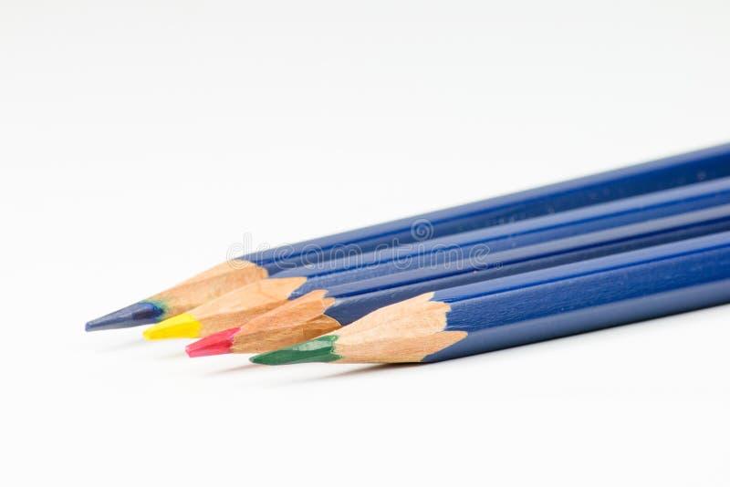 Os lápis coloridos em um fundo branco fotografia de stock royalty free
