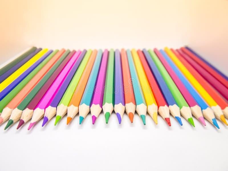 Os lápis diferentes da cor são colocados fotografia de stock royalty free