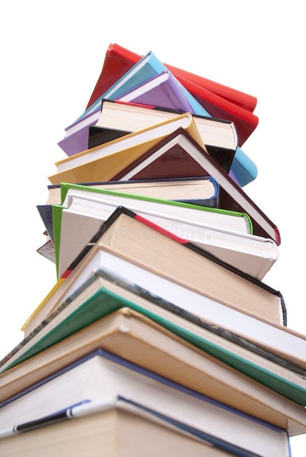 Os livros empilham isolado no branco fotos de stock royalty free
