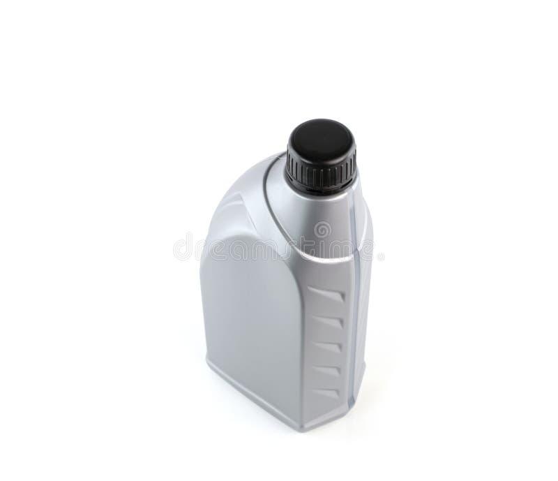 Os lubrificantes engarrafam isolado no fundo branco imagens de stock