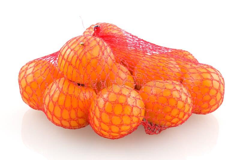 Os mandarino na rede vermelha foto de stock