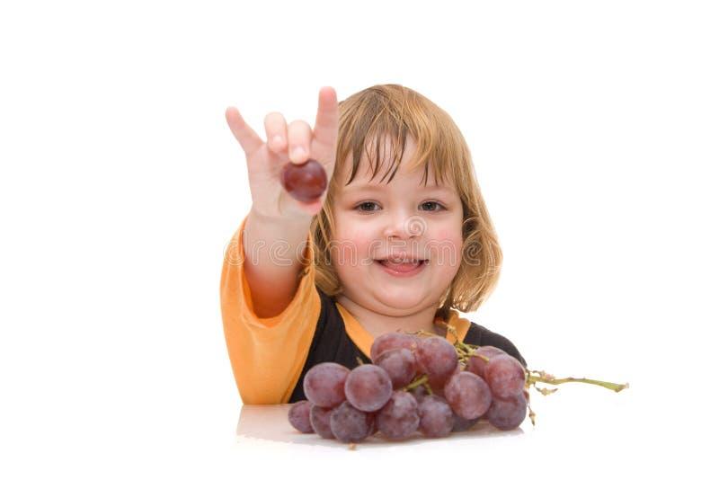 Os miúdos devem comer frutas! imagens de stock