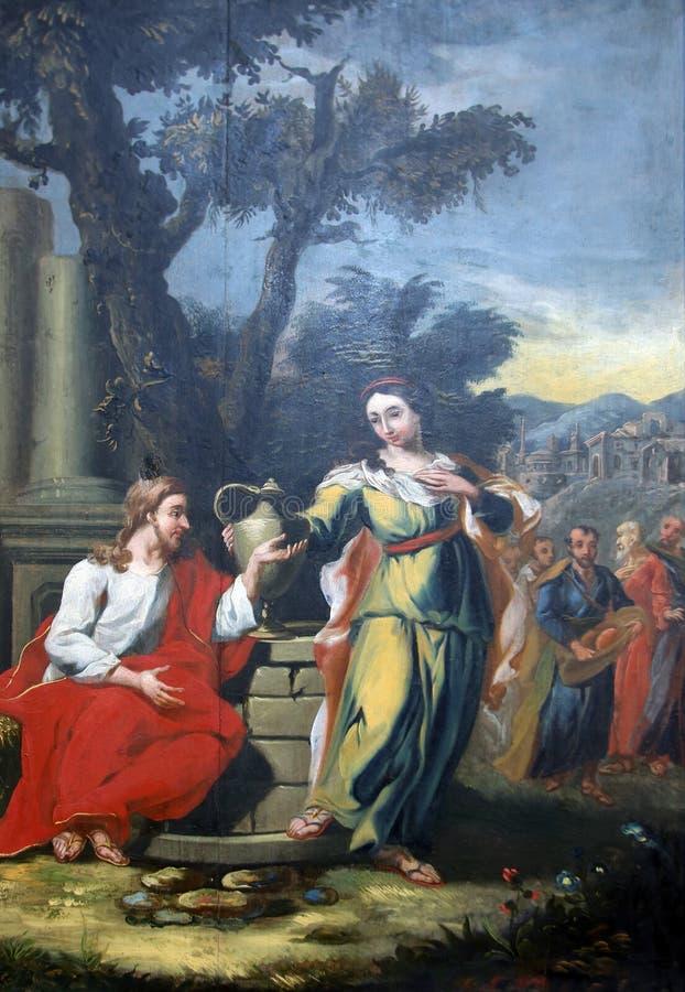 Os milagre atribuíram a Jesus, conversão miraculosa de uma mulher do samaritano fotografia de stock