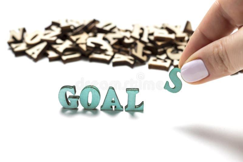 Os objetivos escritos em letras de madeira, o conceito da palavra de ajustar objetivos imagem de stock