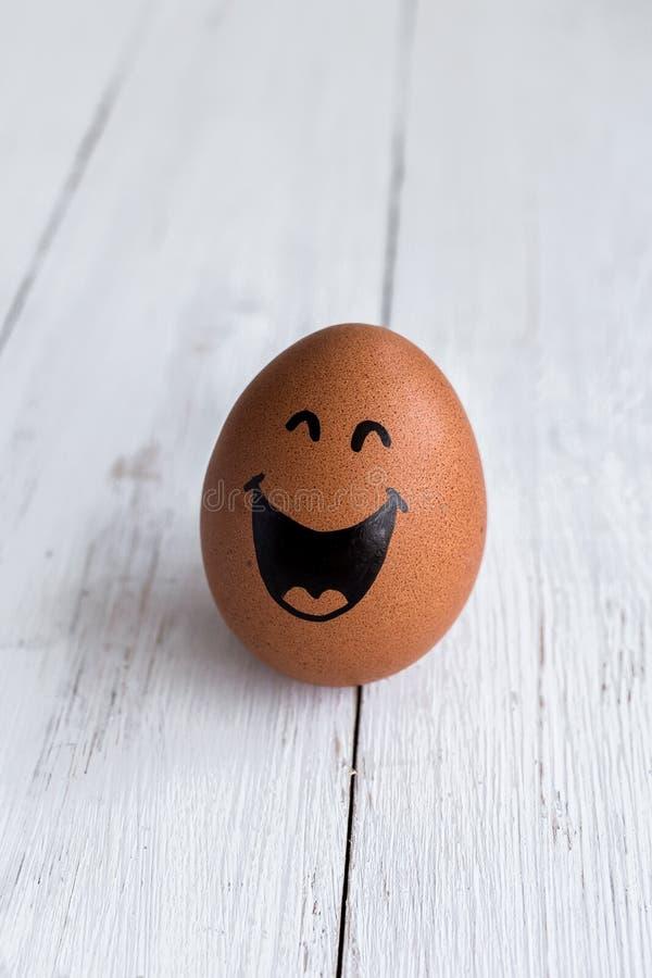 Os ovos enfrentam, drawnigs no ovo, cara engraçada fotografia de stock