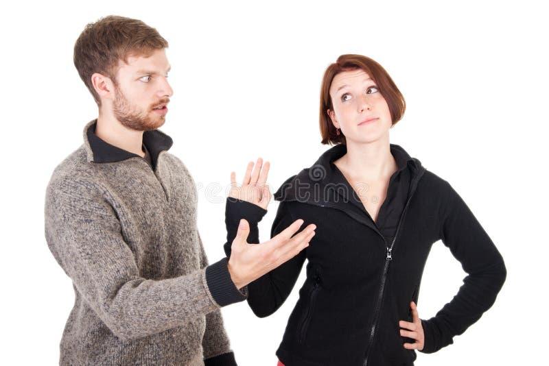 Os pares adultos novos têm um argumento imagem de stock royalty free