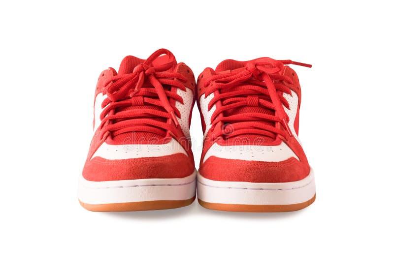 Os pares de gumshoes ou de sapatas vermelhas do patim isolaram-se foto de stock