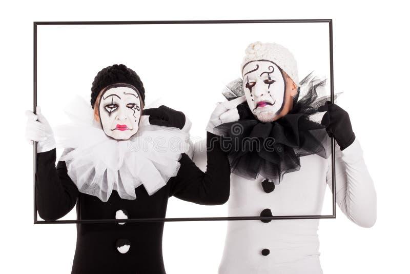 Dois palhaços em um cant do quadro ouvem-se imagem de stock royalty free