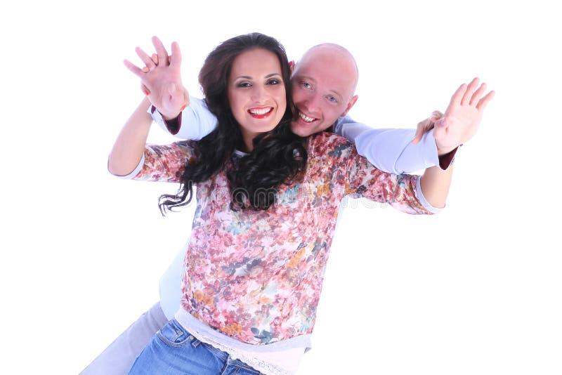 Os pares loving novos felizes com braços abrem fotografia de stock royalty free