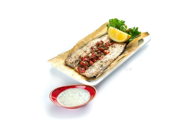 Os peixes cozidos enfaixam com paprika no fundo branco imagem de stock royalty free