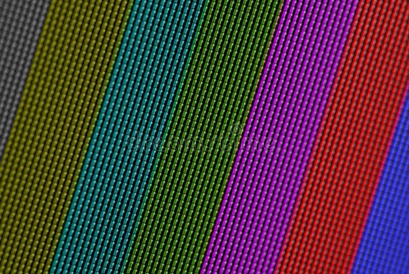 Os pixéis do close up da tela da tevê do LCD com barras de cor são um teste padrão de teste da televisão foto de stock royalty free