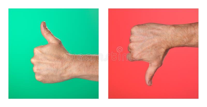 Os polegares acima e os polegares assinam para baixo em verde e no vermelho imagem de stock