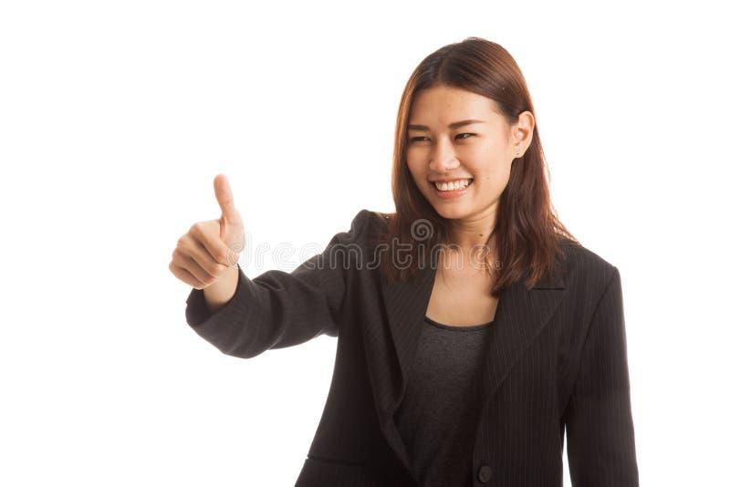 Os polegares asiáticos da mulher de negócio levantam e sorriem foto de stock royalty free