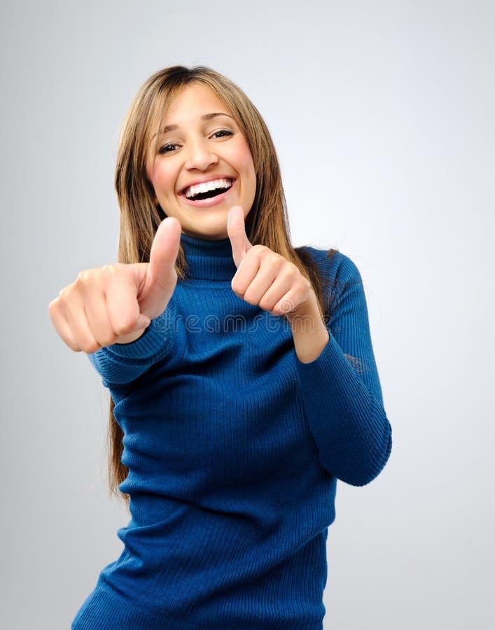 Os polegares felizes levantam a mulher fotografia de stock