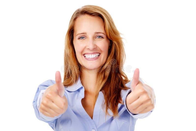 Os polegares felizes levantam a mulher fotografia de stock royalty free