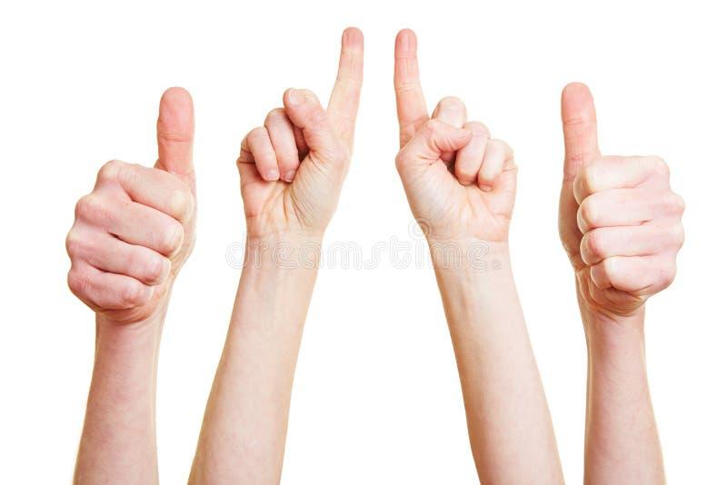 Os polegares levantam e o indicador imagem de stock