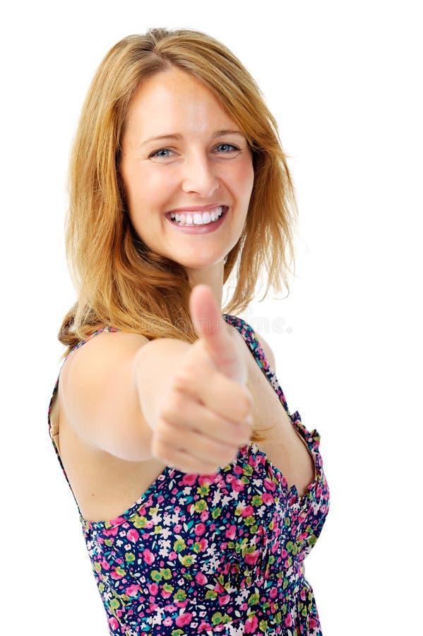 Os polegares levantam a mulher imagem de stock