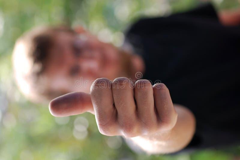 Os Polegares Levantam O Homem Fotos de Stock