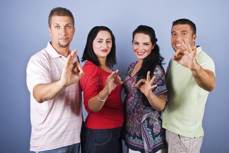 Os povos alegres do grupo mostram sinais aprovados fotografia de stock royalty free