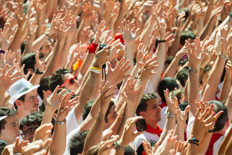 Os povos levantam suas mãos fotografia de stock royalty free