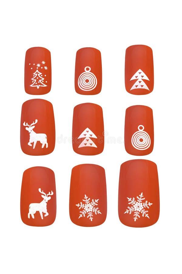 Os pregos falsificados vermelhos decorados temáticos do Natal, isolados no fundo branco, trajeto de grampeamento incluíram foto de stock