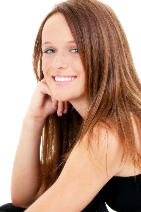 Os quatorze anos de idade bonitos no preto fotografia de stock royalty free