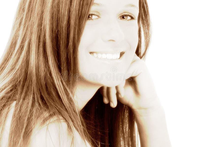 Os quatorze anos de idade bonitos no preto imagem de stock