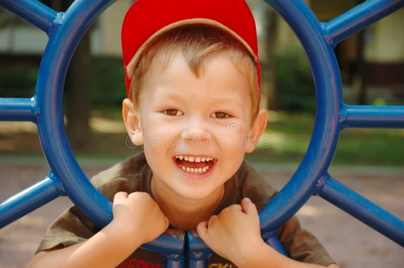 Os risos do menino fotos de stock royalty free