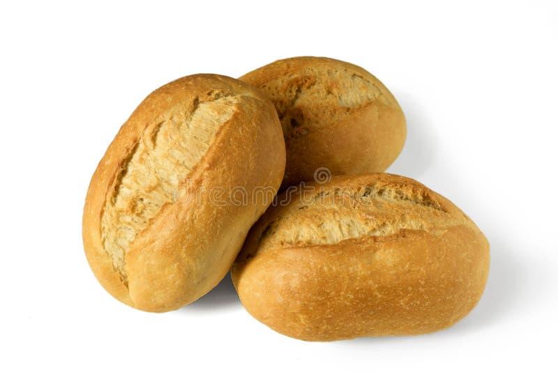 Os rolos de pão pequenos, brötchen - rolos do café da manhã - isolado no fundo branco imagens de stock royalty free