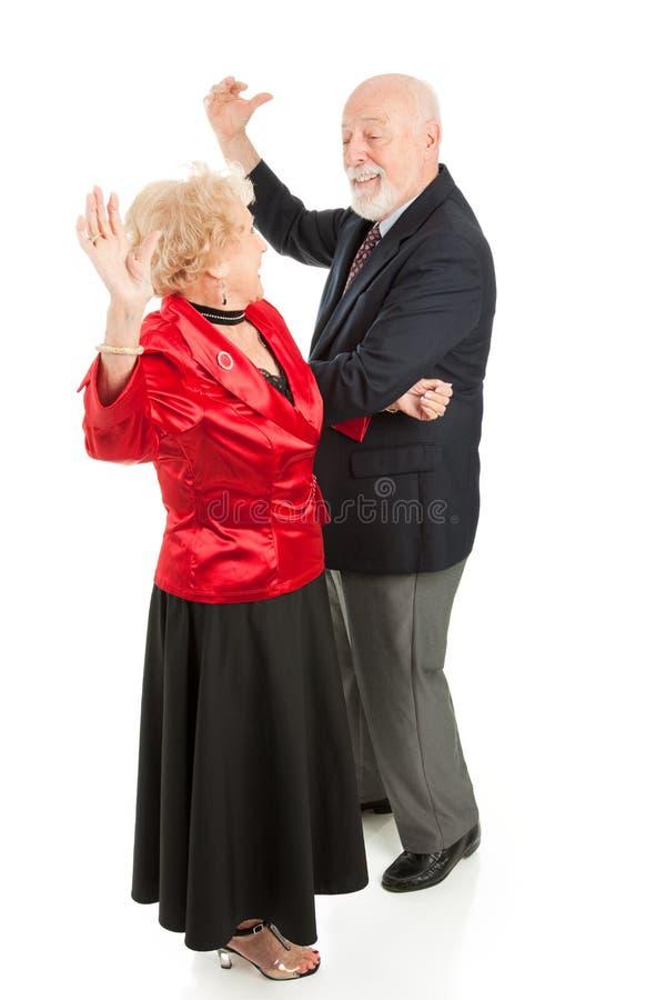 Os séniores dançam a noite afastado fotografia de stock