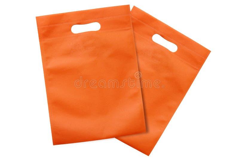 Os sacos alaranjados, pano do eco ensacam para reduzir o aquecimento global, sacos de compras, saco de plástico, reciclando sacos foto de stock