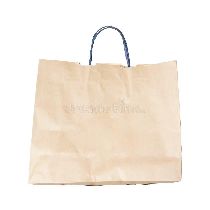 Os sacos de compras de papel marrons reciclados isolados no fundo branco fotos de stock