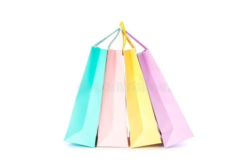 Os sacos de papel multicoloridos isolaram-se fotografia de stock