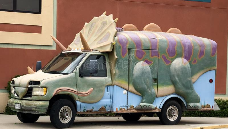 Triceratops Truck. This os a Spring picture of a truck decorated to look like a Triceratops located in Fruita, Colorado in Mesa County.  This picture was taken stock images
