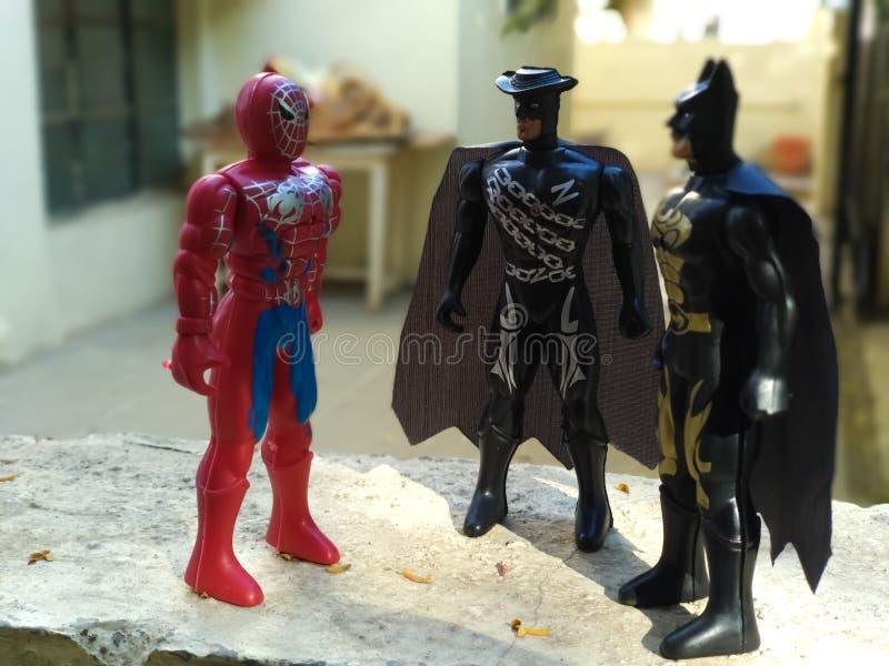 Os superheros da maravilha nos brinquedos formam imagens de stock