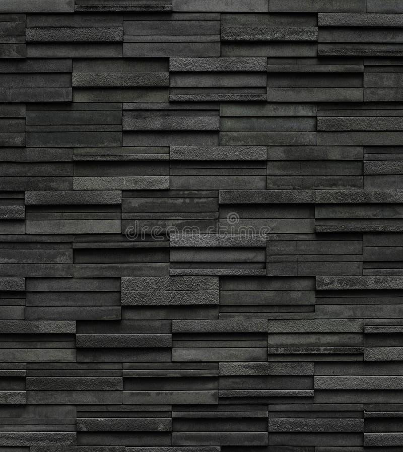 Os tijolos pretos slate o fundo da textura, textura da parede de pedra da ardósia imagens de stock royalty free